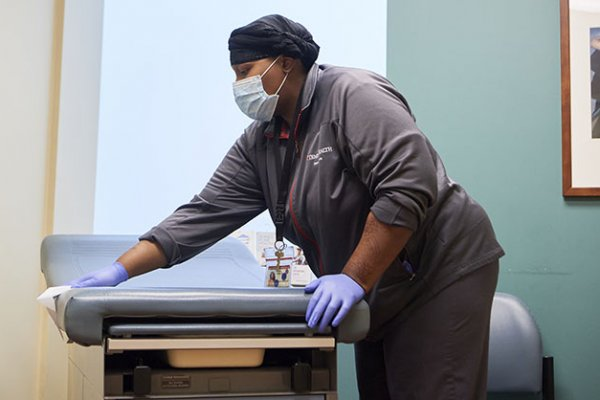 Cleaning and disinfecting patient exam rooms