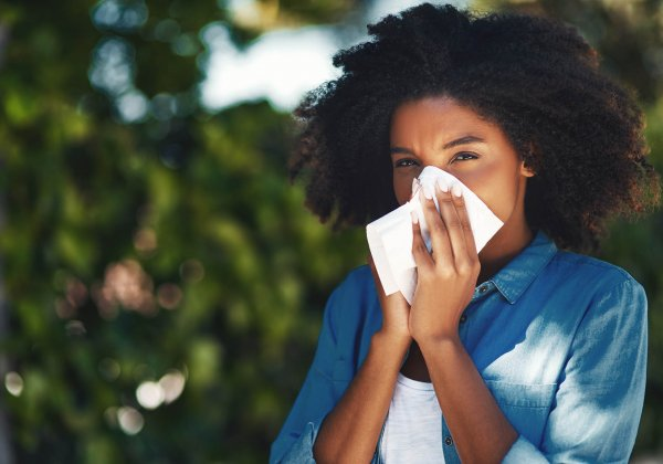 Woman Blowing Nose Outside