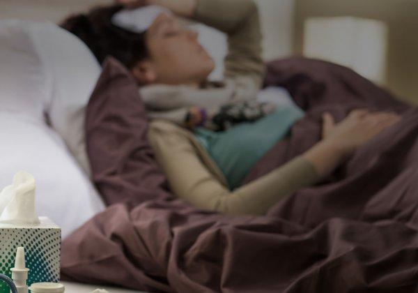 Woman sick lying in bed